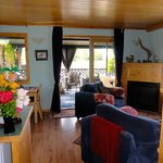 Cosy living area in the Water Garden Cottage. French doors lead to verandah with soaker tub