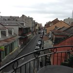 The balcony at the corner of Bourbon and Toulouse