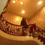 Lobby stairwell decorated for holidays..Victorian spirit!