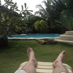 lazing by the pool at Alona Swiss