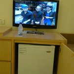 Flat screen TV and also mini bar