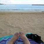 My toes in the sand on Waikiki beach.