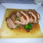 Slow Roasted Duck Breast with Brussel Sprouts, Duck Confit Hash, Oregano, Pomegranite Scented De