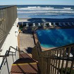 Picture from 2nd floor deck looking down on pool/beach