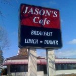Jason's sign on El Camino with bldg in back