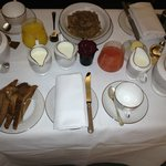 Crowded in-room continental breakfast for 2