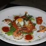 Fried quail's egg with sea bass and shrimp
