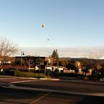 hot air balloons heading out over Yountville