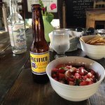 a delicious lunch, shrimp ceviche and a beer