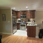 Well-equipped kitchen, with dining area to right, suite 404