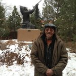 "Artist and tribal chief Gerald ""New Deer"" Nailor in front of statue he selected for the grounds"