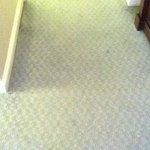 Dirty and worn carpet in the room.