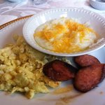 Grits, eggs and sausage at Degas House