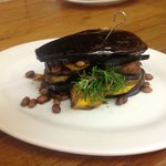 Egg-plant stack filled with grilled courgette, field mushroom, spinach, kumara and pomigranite s
