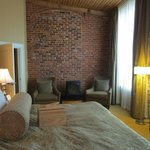 Room 401's bedroom, showing open-face brickwork design and height of room and windows