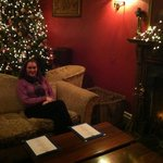 sitting by the fire in the front drawing room