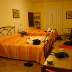 Our spacious room with one double and two single beds