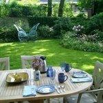 In summer, enjoy breakfast in the back garden.