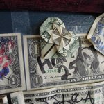 We left a Heart $1 we folded. Hopefull it's still there! Under the TV by the hostess...