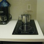 stove & coffee maker in room