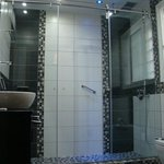 Pure luxury in the bathroom, with this huge shower featuring a rain shower head.