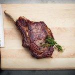 Dry aged bone-in Ribeye for two carved tableside