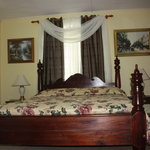 Luxurious Suite beautifully decorated with king size antique four poster machongy bed