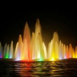 Coloured lights in fountains at QE Park at night