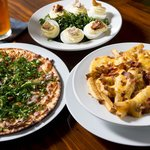 Pork, blue cheese, and collard pizza. Deviled eggs. Pimento cheese and bacon fries.