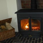 Warm yourself by the cosy log fire