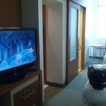 Shared TV, bathroom in front of the beds