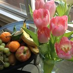 In room fruit bowl and flowers from market