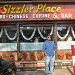 Sizzler cafe at the entrance to the hotel