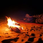 with my guide by the campfire