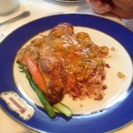 fish topped with ettouffee sauce