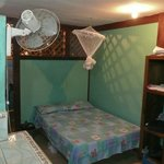 Room where I stayed. It has a small kitchen with a mini fridge and a bathroom with hot shower.