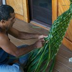 Weaving a basket out a single palm leaf