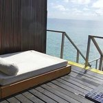 Our own sunlounger next to our plunge pool and stairs to our private lagoon