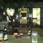 Two sides of the courtyard in the evening, with delicious food made by staff