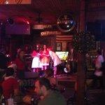 xmas carollers performing at the Old Point bar
