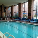 Indoor pool, lounges and whirlpool. Outdoor pool is to the right.