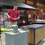 Instructor Jeremy demonstrating how to make glass flower