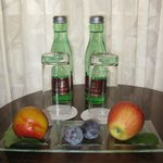 Bottled water and fruit provided in the room