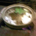 shabu shabu bubbling over hot coals