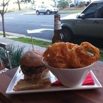Pork Burger, Onion Rings and Burleigh Beer! This place is a slice of heaven. Perfect location, w