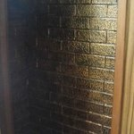 V cool brass-coloured exposed bricks...hidden in the cupboard!