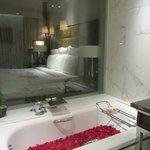 Lovely spacious bath room with bath tub in premium club room
