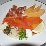 Iberico ham, fresh cut whole smoke salmon, served with Cantaloupe