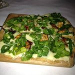 Grilled Flatbread with Chantrelle Mushrooms, Arugula Tossed with Sherry Vinaigrette and Cheese.