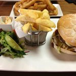 The yummy LFC burger with homemade chips, salad and onion rings